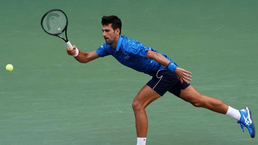 Novak Djokovic zieht souverän in die zweite Runde ein - Bildquelle: AFPAFPTIMOTHY A. CLARY