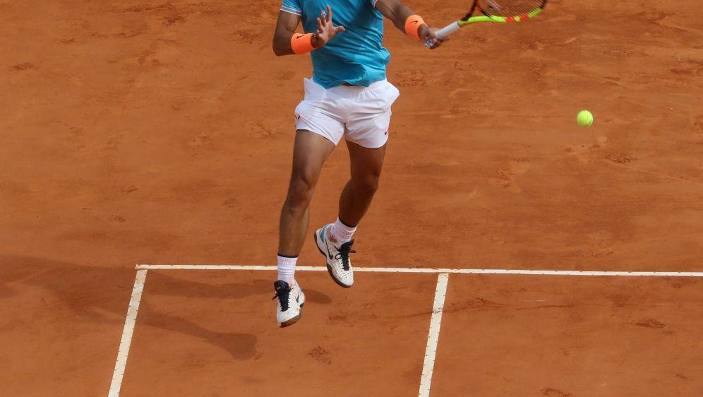 Sandplatzkönig Rafael Nadal (Foto) scheitert an Fognini - Bildquelle: AFPSIDVALERY HACHE