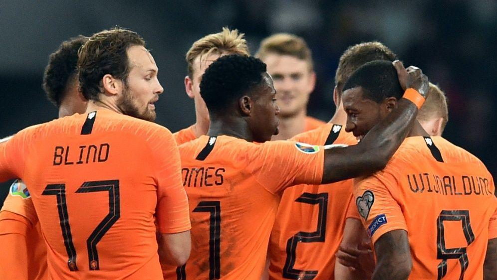 Oranje bejubelt einen knappen Sieg in Weißrussland - Bildquelle: AFPSIDSERGEI GAPON