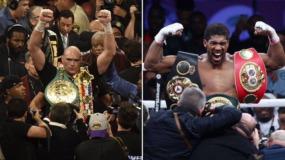 Es kommt zum Boxkampf der Superstars: Die Schwergewichts-Weltmeister Anthony... - Bildquelle: Imago