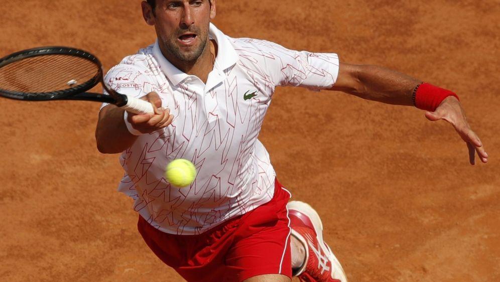 Novak Djokovic ist über seinen Finalgegner überrascht - Bildquelle: AFPSIDCLIVE BRUNSKILL