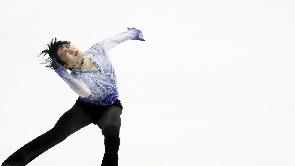 Stellte einen neuen Weltrekord auf: Yuzuru Hanyu - Bildquelle: AFPSIDJUNKO KIMURA-MATSUMOTO