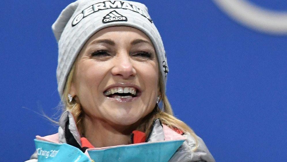 Aljona Savchenko ist eines der vielen Olympia-Gesichter - Bildquelle: AFPSIDDIMITAR DILKOFF