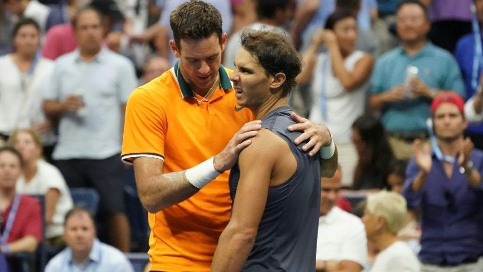 Del Potro (r.) tröstet den angeschlagenen Nadal - Bildquelle: AFPSIDTIMOTHY A. CLARY
