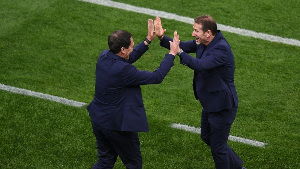 Franco Foda (r.) und sein Team haben was zu feiern - Bildquelle: AFPPOOLSIDMIHAI BARBU